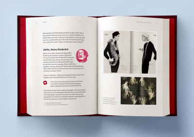 A hardcover book laying open on a light blue background, with two pages open that are showing some artwork examples from the 1930s, by Alexey Brodovitch