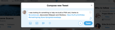 Twitter message with hashtags and handles