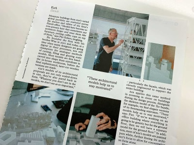 A photograph of a magazine article with text, quotes and images in boxes