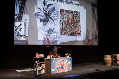 Stage with a presenter, with illustration on a large screen