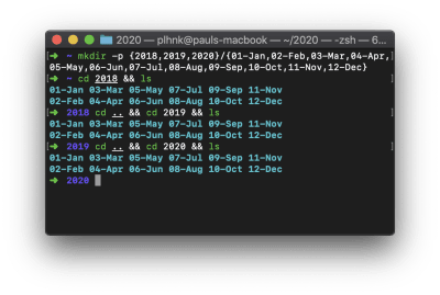 A screenshot of a terminal window showing the commands and output of a folder creation script.